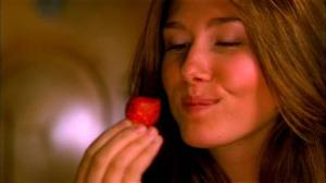 Kaylee eats a strawberry
